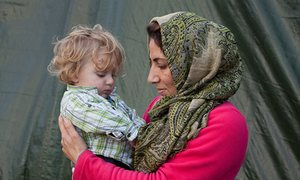 Leyla and her daughter Sara, from Iraq, in the 'Jungle' refugee camp, Calais